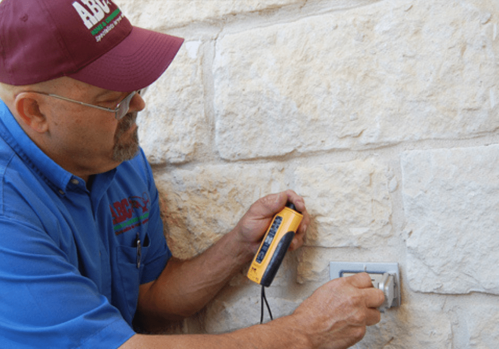 a commercial electrician testing a business' outlets
