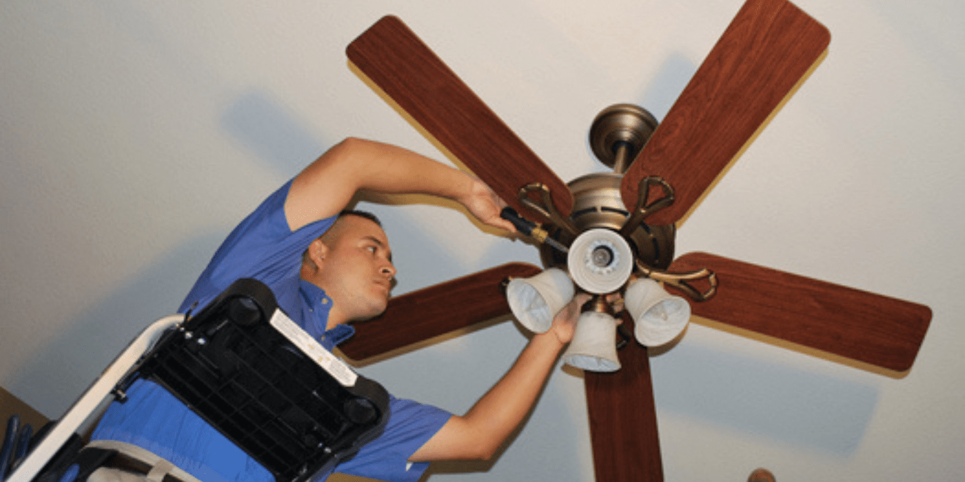 a licensed electrician fixing a homeowner's lights