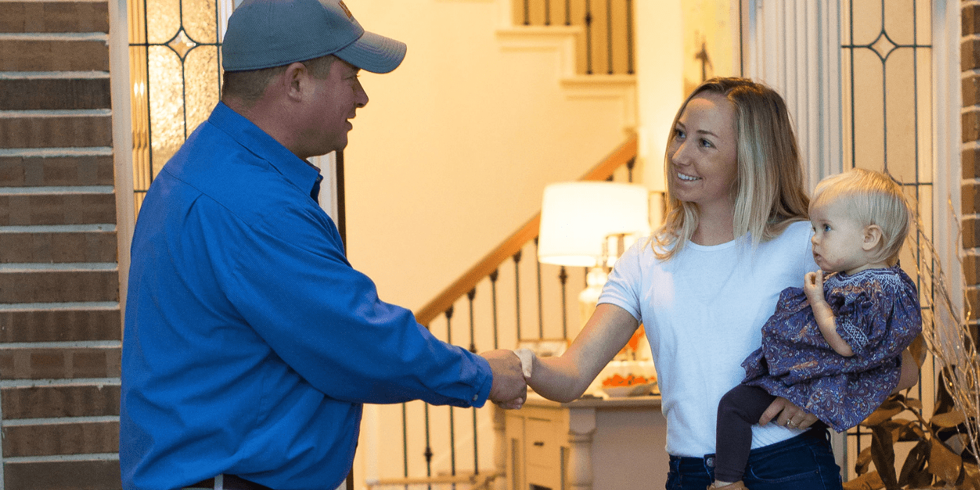 a licensed appliance repair specialist greeting a homeowner who is in need of refrigerator repair