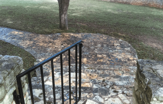 stone pathway before being power washed