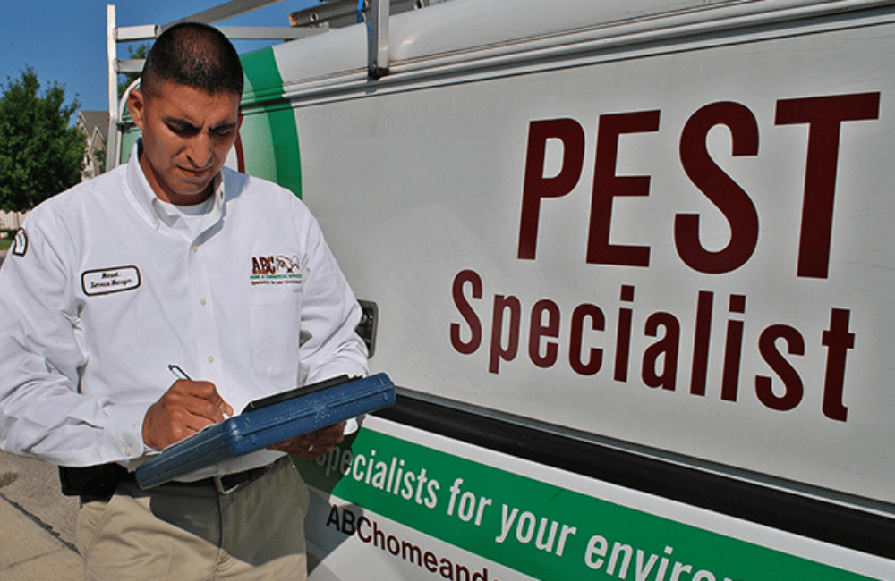 an ABC pest control specialist creating a custom treatment plan for a customer