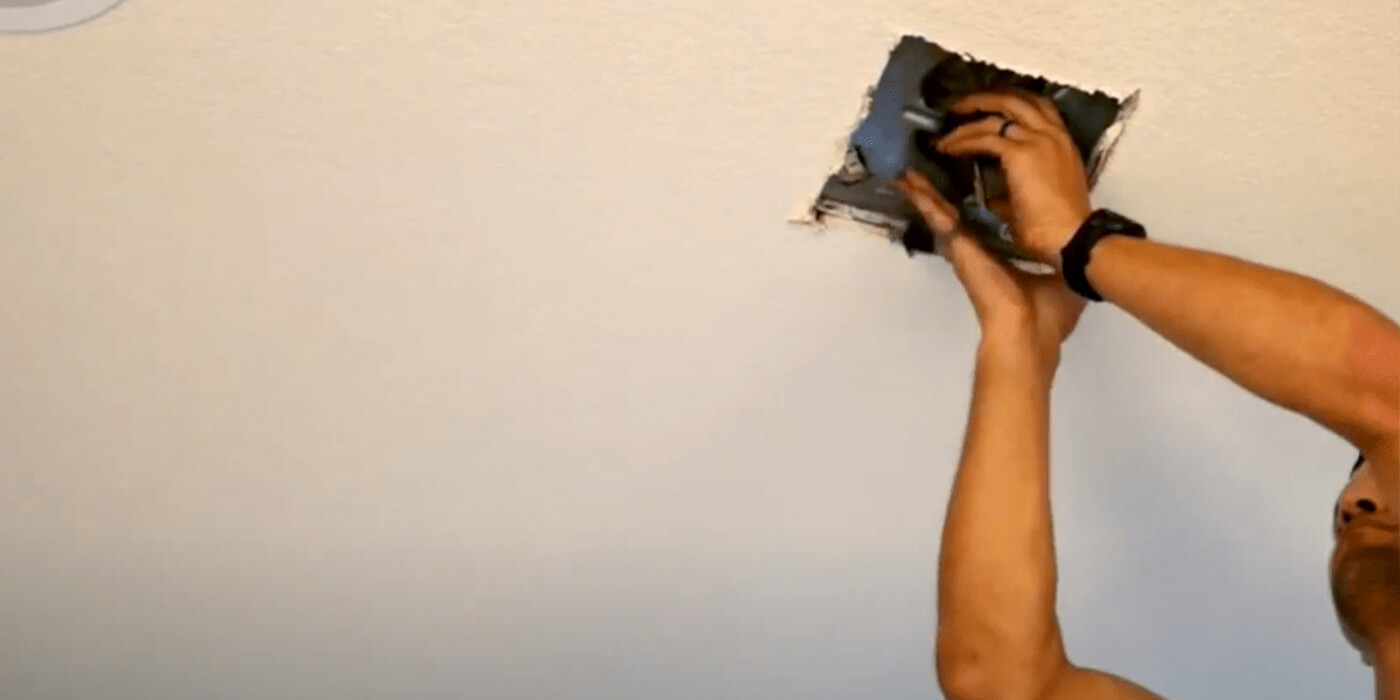 a licensed electrician fixing a homeowner's electrical outlet