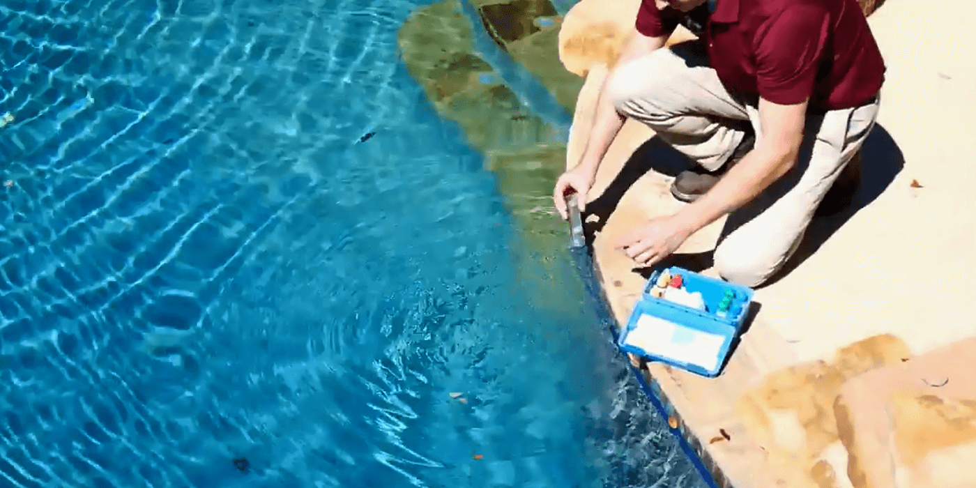a certified pool and spa professional cleaning a homeowner's pool