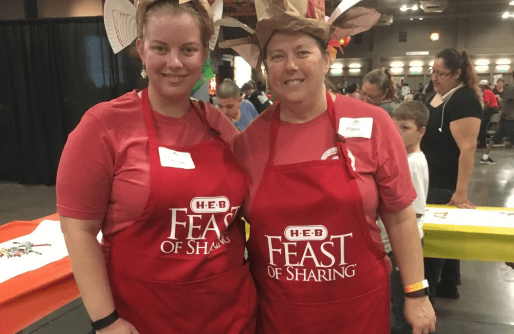 two ABC team members volunteering at an event for United Way