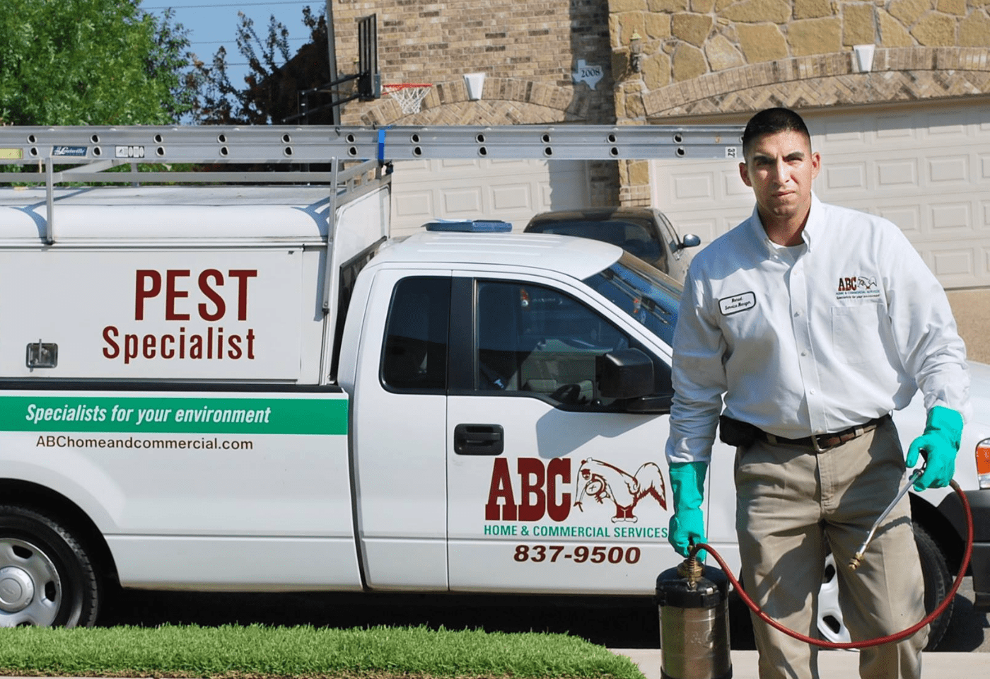 an ABC pest control specialist arriving at a home for treatment
