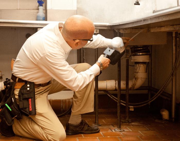 an ABC pest specialist inspecting a restaurant