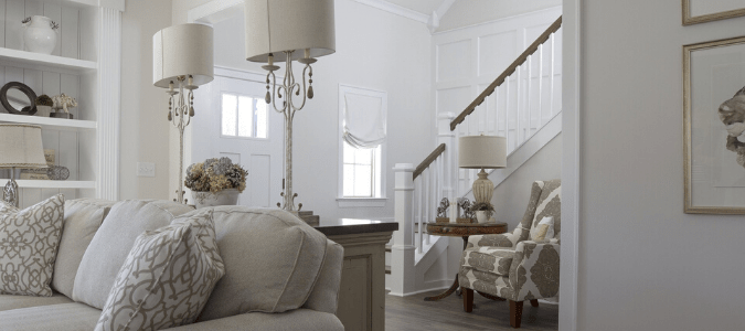 a white and gray living room and entryway