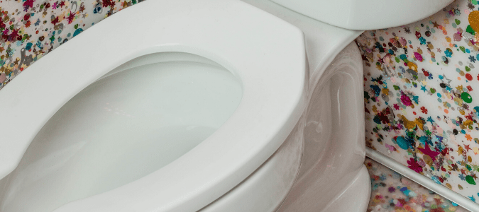 a toilet bowl that is slowly draining