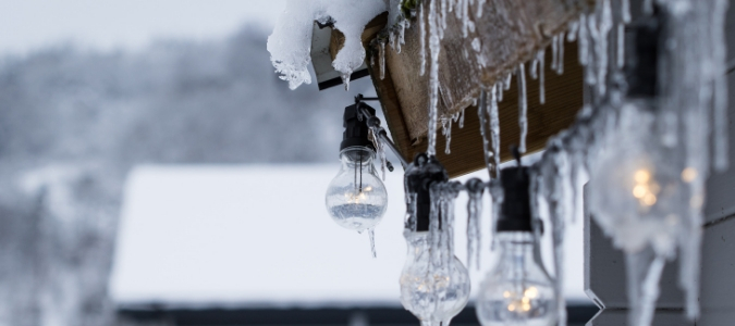 snow and icicles on a roof