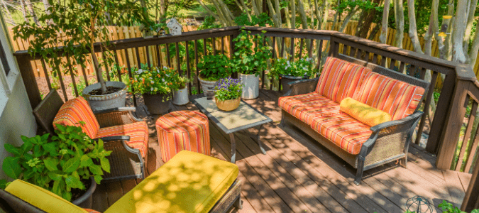 A deck with orange and yellow furniture