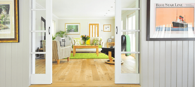 A living room with hardwood floor and termites in furniture