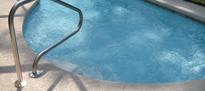 A swimming pool with cloudy pool water