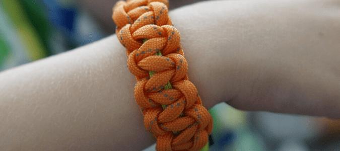 An orange mosquito repellent bracelet