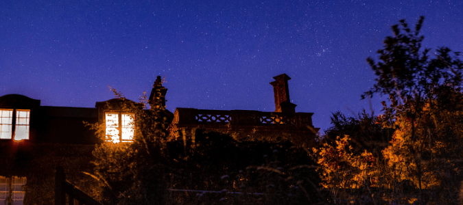 A house and garden at night