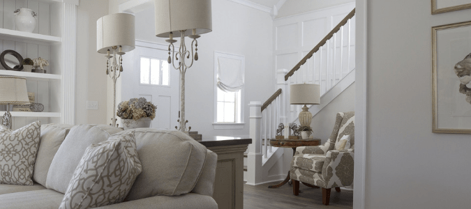 A white living room with a beige couch