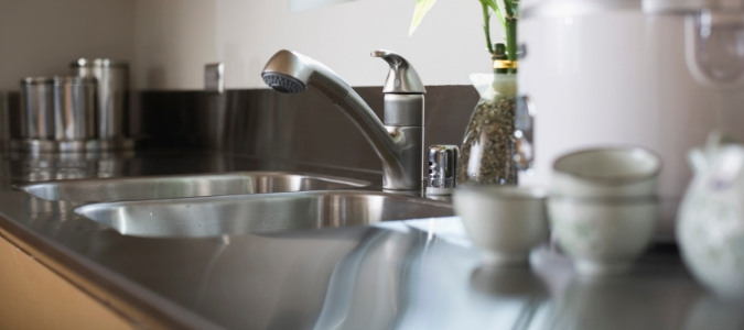 A stainless steel sink with a garbage disposal