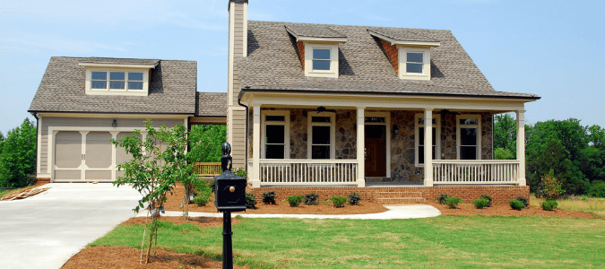 The front yard of a home that is suffering from zoysia brown patch