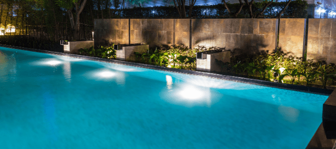 A yard where a homeowner has recently updated their landscape lighting around the pool