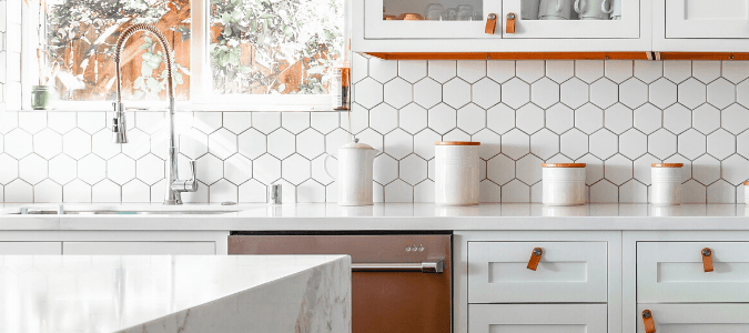 a kitchen with white tile