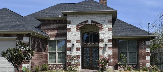 a brick house with tall windows