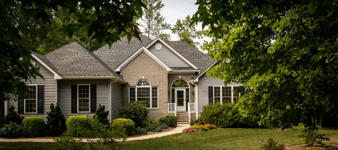 a home with lots of big trees in the front yard which could mean the homeowner should pressure wash their house more often