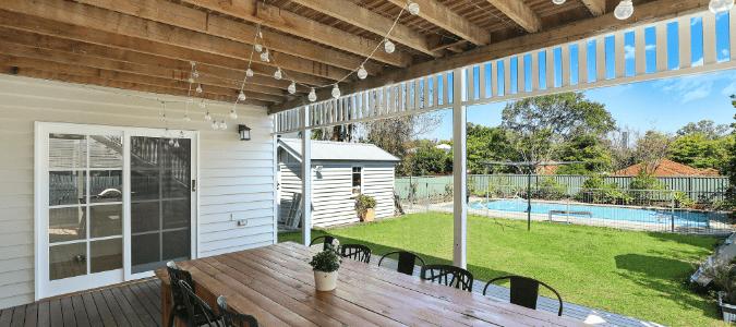 a backyard with a deck