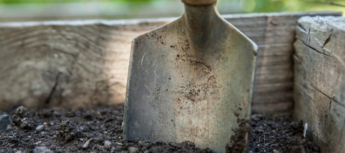 a shovel in a compost pile