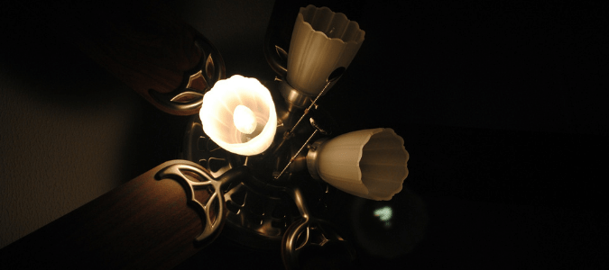 a ceiling fan with three flickering LED bulbs