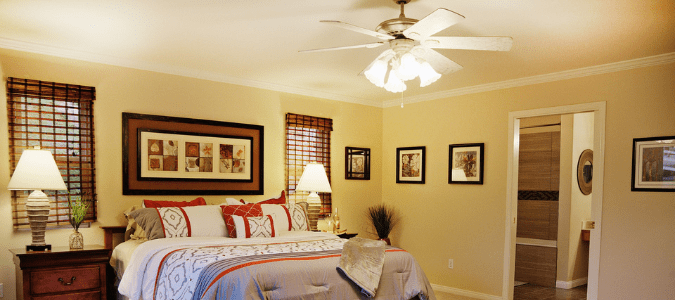 a bedroom with a ceiling fan that stopped working
