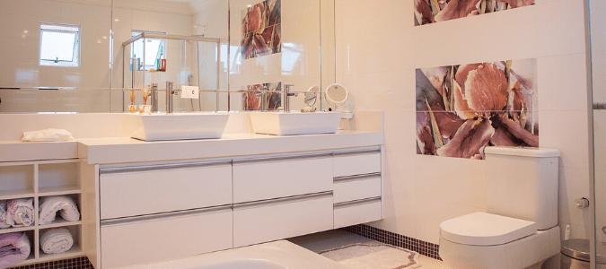 a toilet in a white bathroom