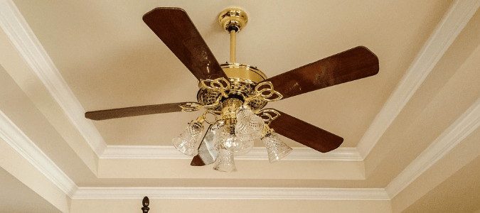 a wooden ceiling fan with LED bulbs
