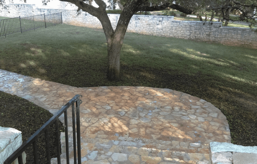 a clean stone walkway after being power washed by ABC experts
