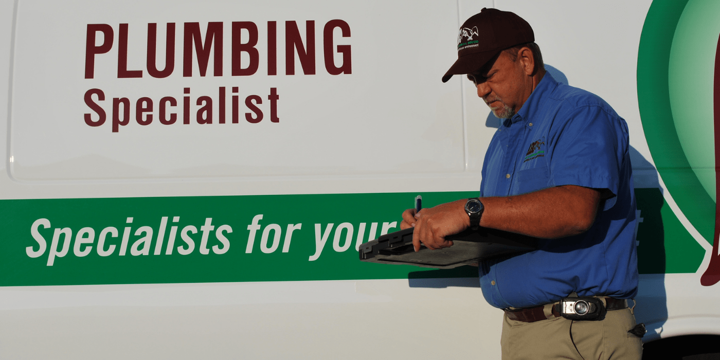 a specialist writing up a report on a homeowner's water quality