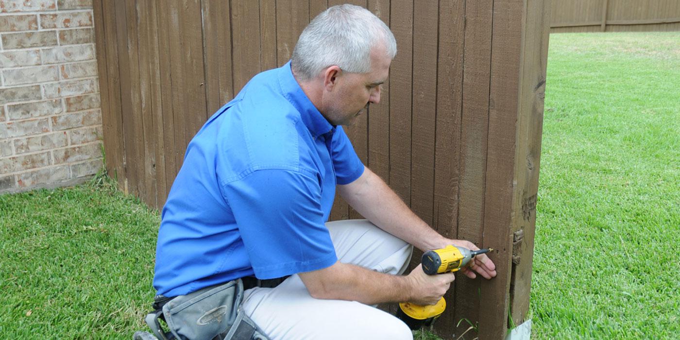 a handyman installing a new door for a customer