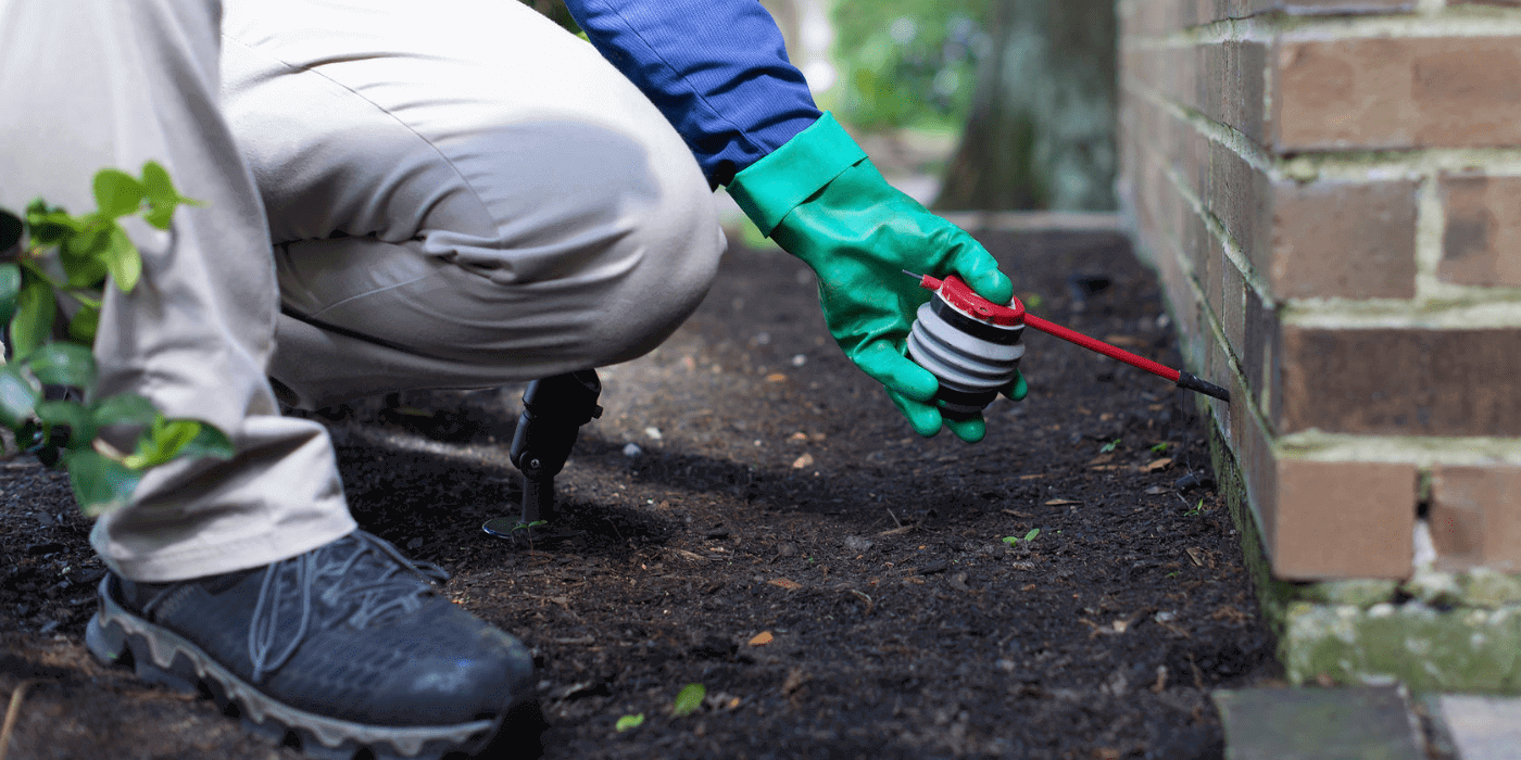 an ABC specialist treating a home for fire ants
