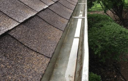the same gutter after it has been cleaned by ABC specialists. All of the dirt and debris is gone.