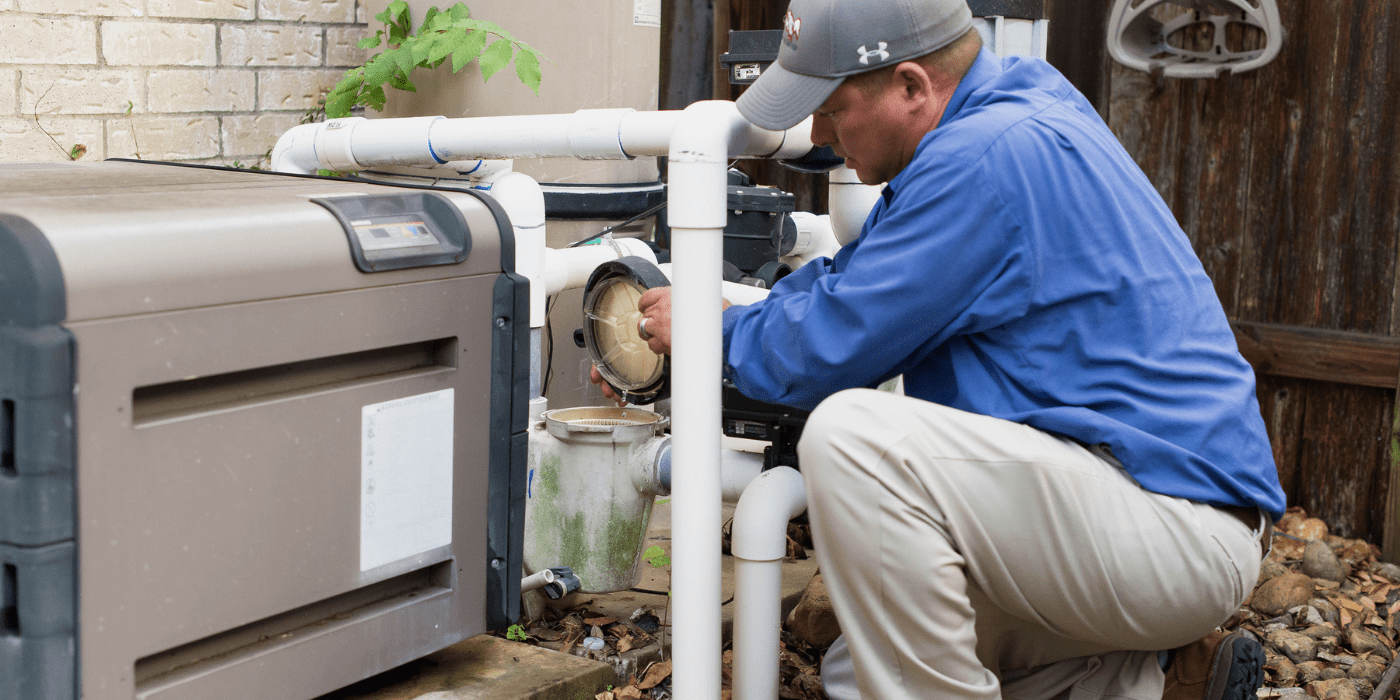 a certified pool and spa professional repairing a homeowner's pool pump