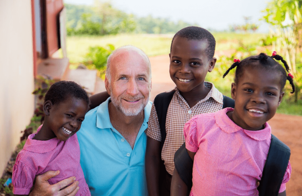 Raleigh Jenkins with children from the Child's Hope orphanage