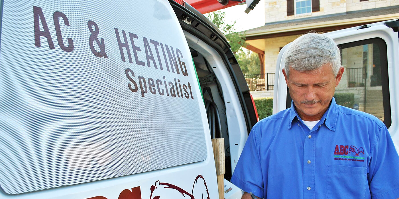 an HVAC specialist writing a report on a homeowner's heating and cooling