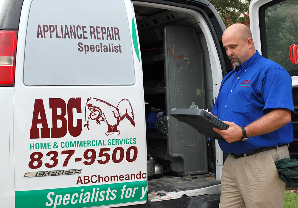 an ABC appliance repair specialist writing recommendations for commercial services