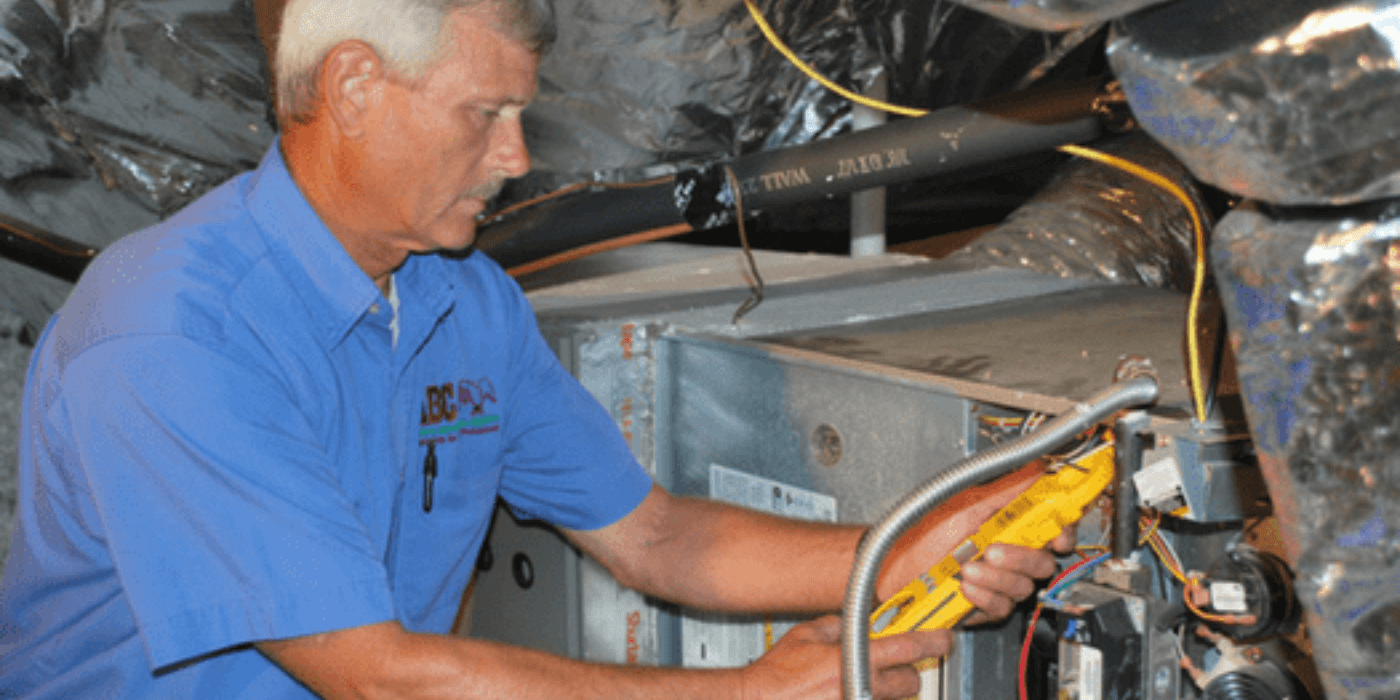 an HVAC specialist writing a report on a homeowner's heating and cooling system