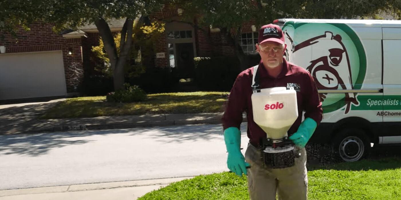 an ABC lawn care specialist providing lawn maintenance services