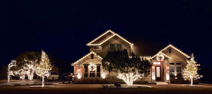 a house that hired ABC to hang up their Christmas Lights