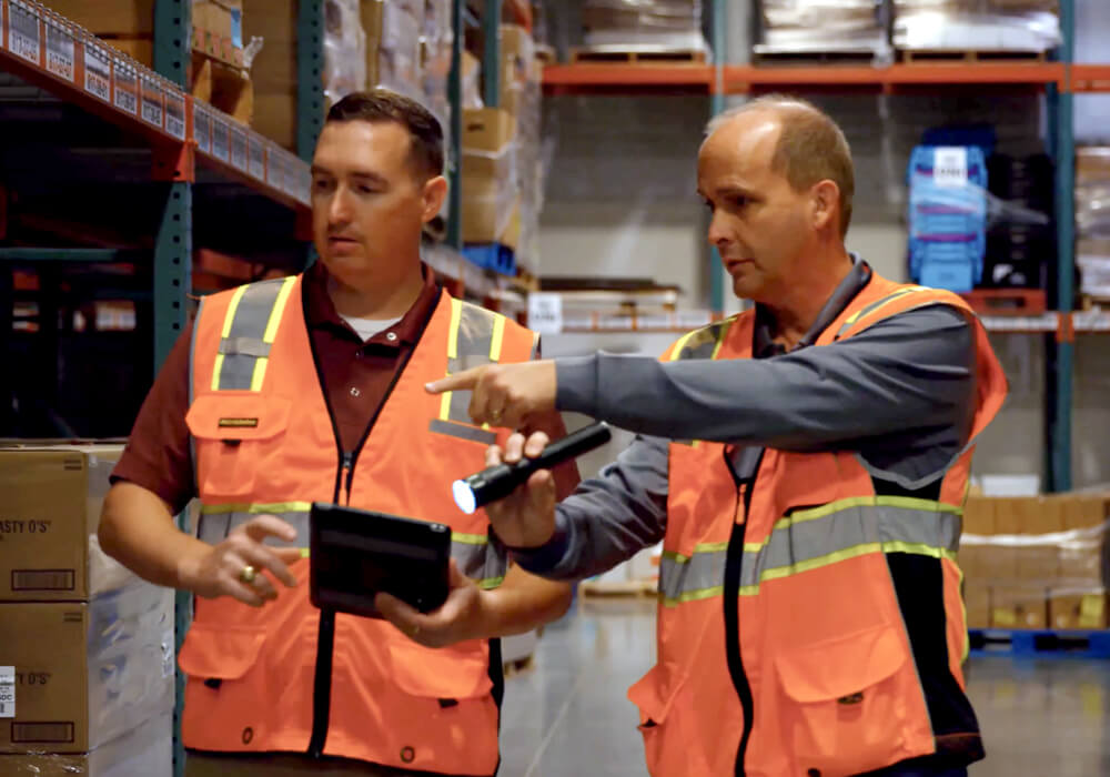 two ABC employees working in a warehouse