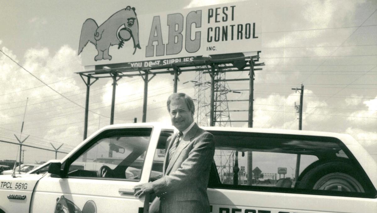 Bob Jenkins Sr. standing in front of an ABC billboard
