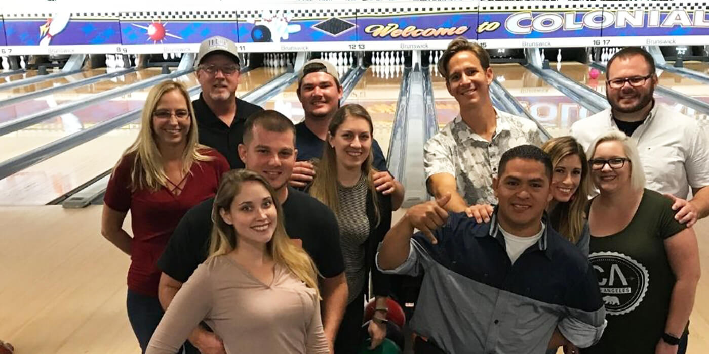 a group of ABC employees bowling together