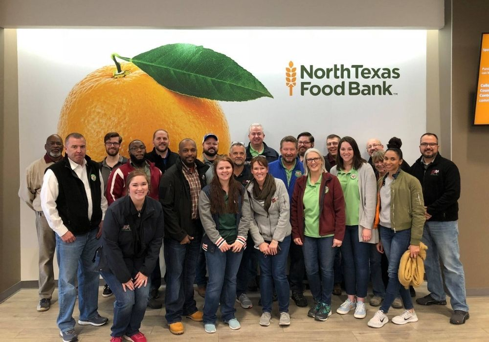Dennis with ABC employees volunteering at the North Texas Food Bank