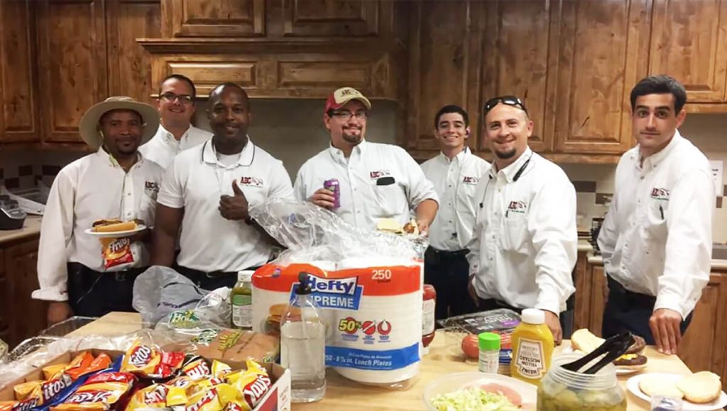 a group of ABC employees volunteering in a kitchen