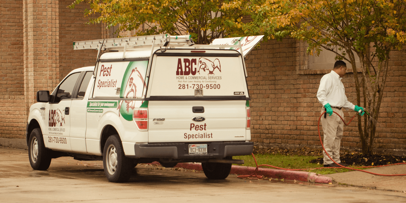 a pest control specialist treating an apartment complex for pests