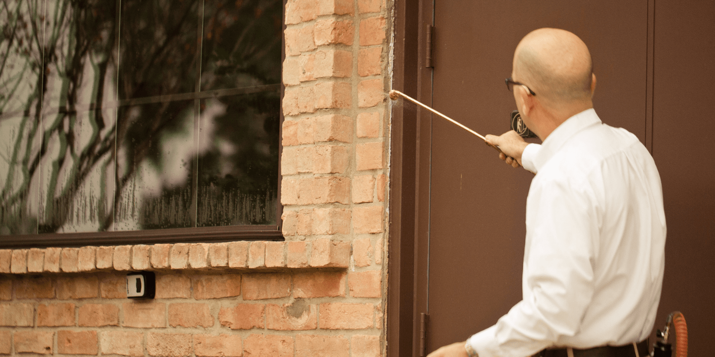 a commercial pest control specialist treating a business for pests
